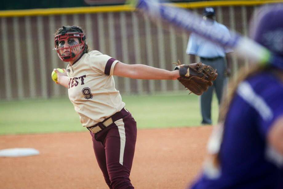 Magnolia West's Ariana Adams (9) throws a pitch during the high school softball game against Willis on Friday at Magnolia West High School. To view more photos from the game, go to HCNPics.com. Photo: Michael Minasi