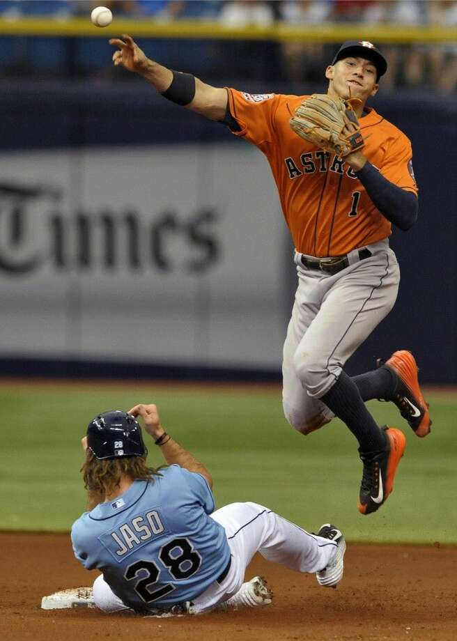 Houston Astros shortstop Carlos Correa, right, throws to first after forcing out Tampa Bay Rays' John Jaso at second base. A run scored on the play and the Rays defeated the Astros 4-3. Photo: Steve Nesius