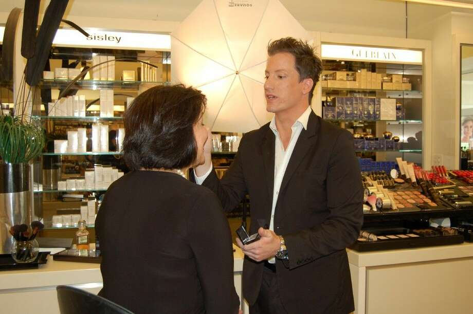 At Cos Bar at Market Street - The Woodlands, make-up artist Cliff McAden shares tips with a customer on how to save time with savvy application techniques and quality skin care products.