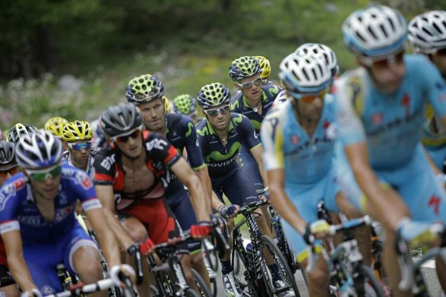 Tour de France riders, including Spain's Alejandro Valverde, center, jockey for position early in the 14th stage of the race. Photo: Laurent Cipriani