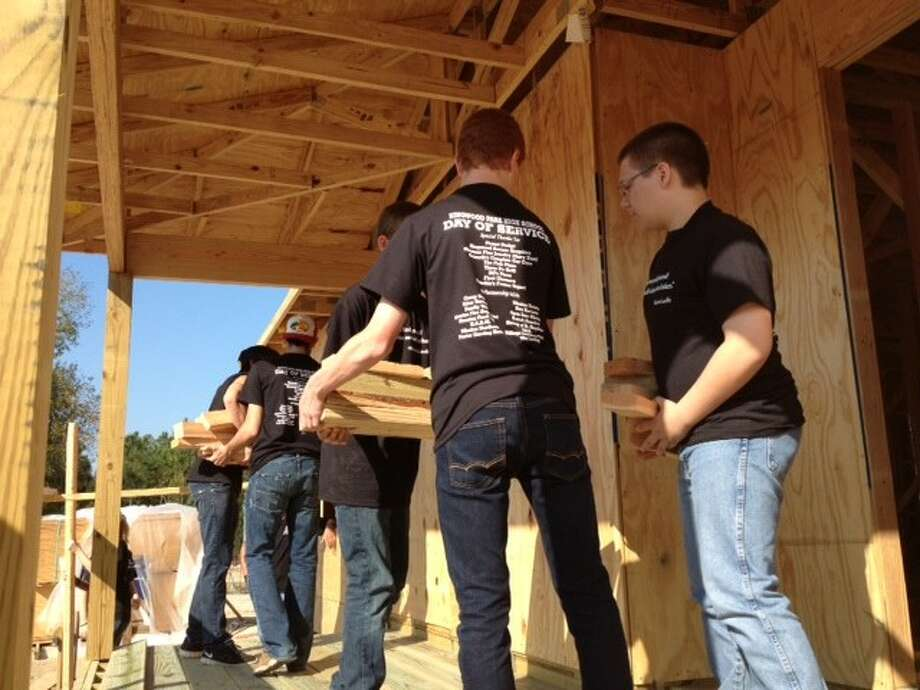 Kingwood Park High School students work together to construct a wheelchair ramp during last year's Day of Service.