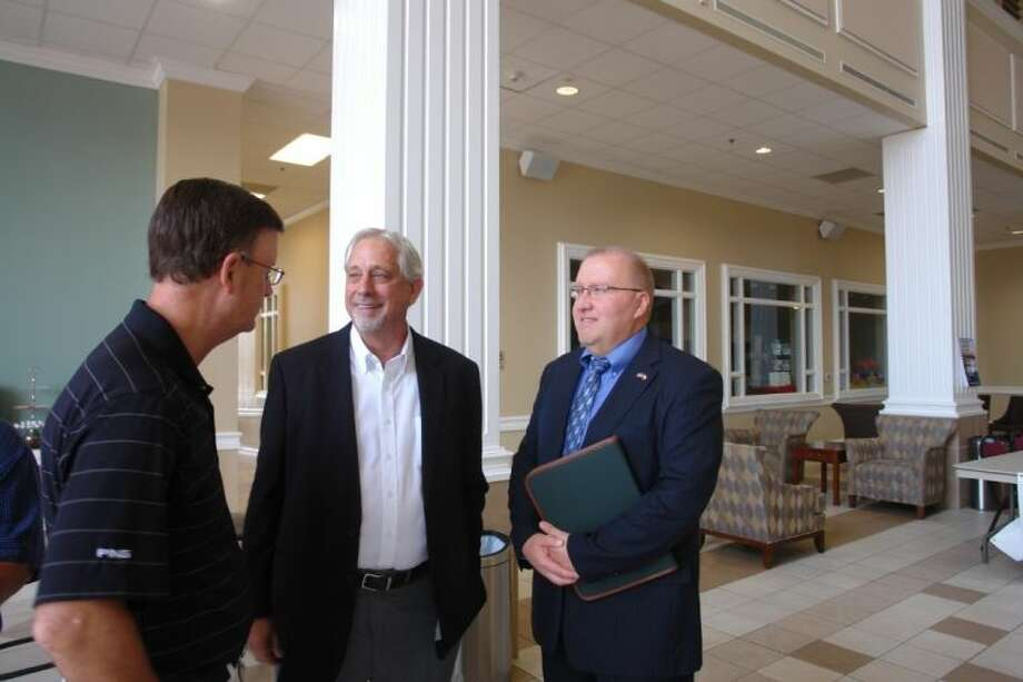 Judge Wayne Mack, right, speaks with First Baptist Church of Conroe Pastor Mark Denison, and Trinity Baptist Church in Willis Pastor Darrell Seale before the Chaplaincy Program luncheon inside First Baptist Church of Conroe on Monday.