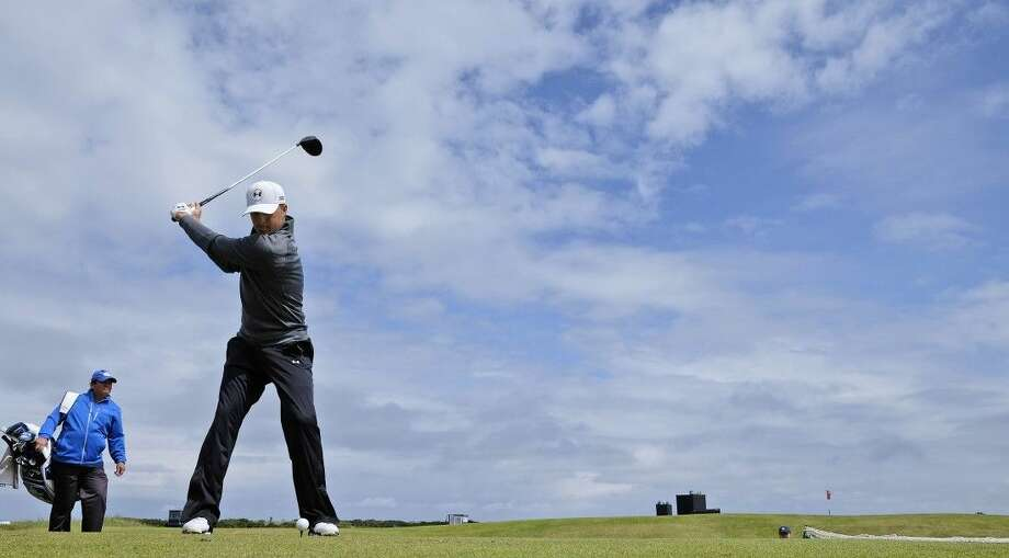 United States' Jordan Spieth drives a ball during a practice round at the British Open Golf Championship at the Old Course, St. Andrews, Scotland, Wednesday. Photo: David J. Phillip
