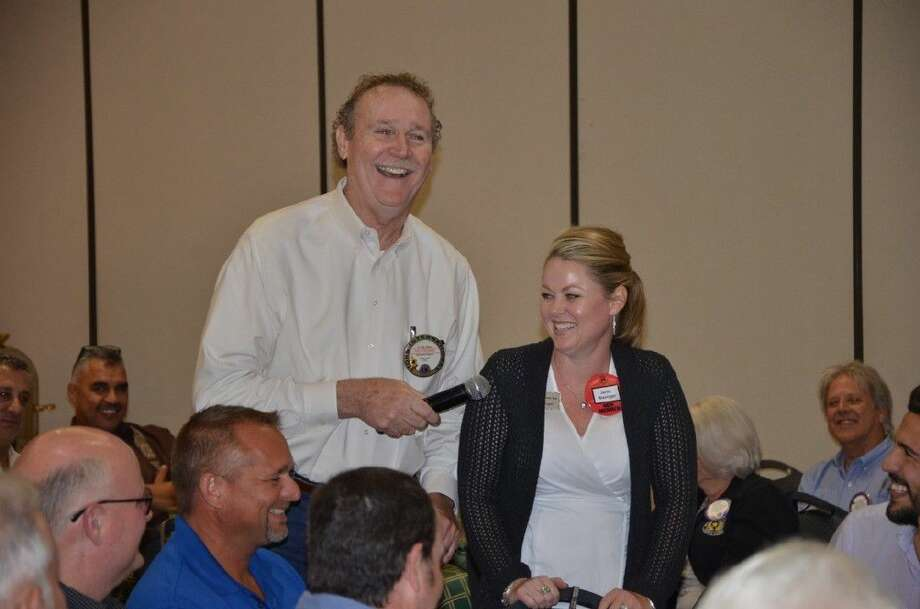It was all laughs last week at the Conroe Noon Lions Club meeting as Lion C. Pat Davis, left, held a Q & A with the club's newest members, such as Jerlin Basinger.