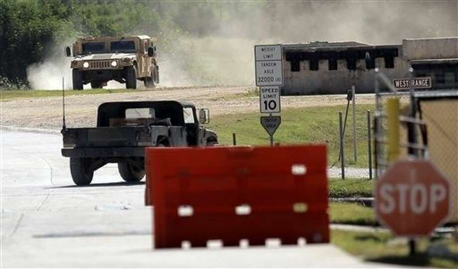 Military vehicles are seen at Texas Army National Guard Camp Swift, Wednesday in Bastrop, Texas. Jade Helm 15, a summer military training exercise, that has aroused alarm among archconservative Texans, begins Wednesday outside the Central Texas town of Bastrop. Photo: Eric Gay