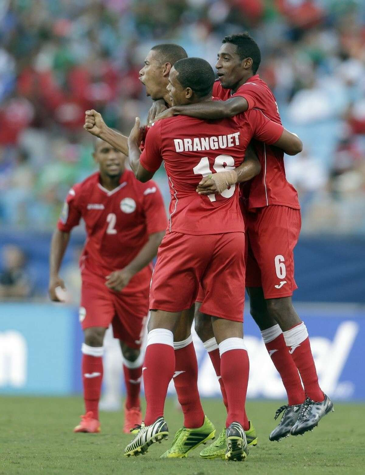 Cuba players celebrate after a CONCACAF Gold Cup soccer match against Guatemala in Charlotte, N.C., Wednesday.
