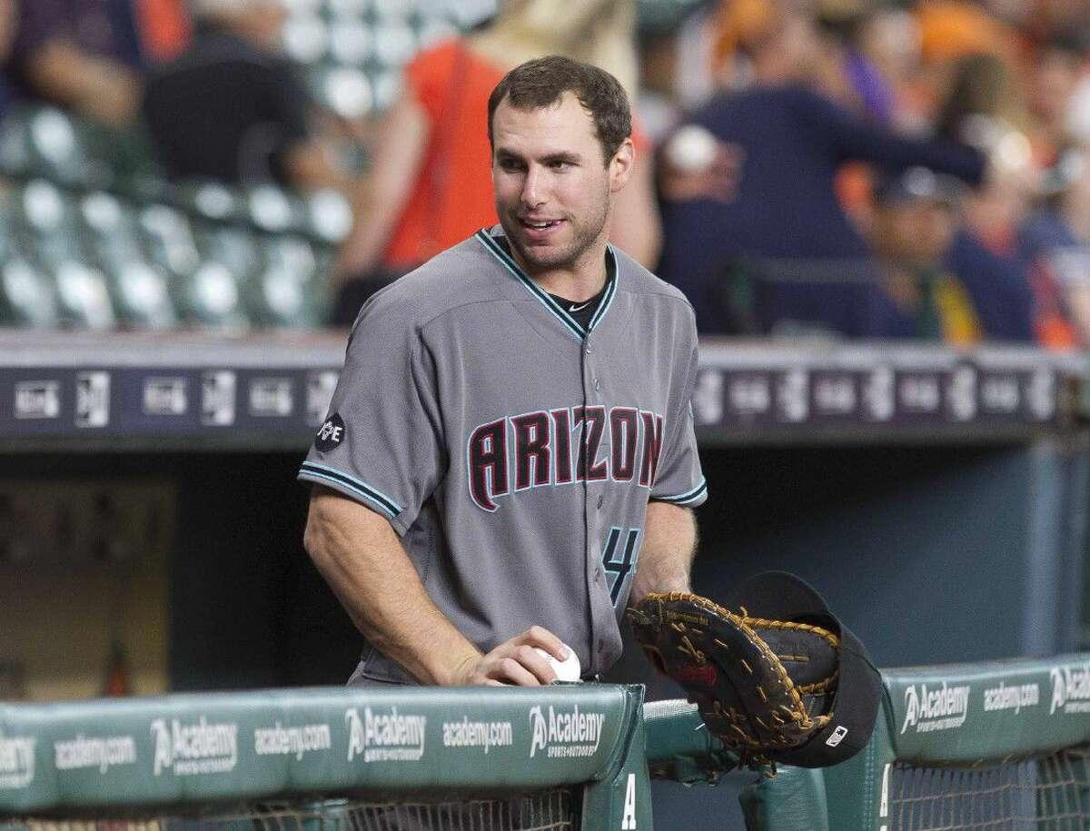 Arizona Diamondbacks first baseman and TWHS graduate Paul Goldschmidt laughs before a baseball game Thursday in Houston.