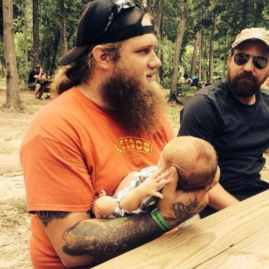 Jonathon Want holds his infant son Kannon in a photo posted on his Facebook page July 20.