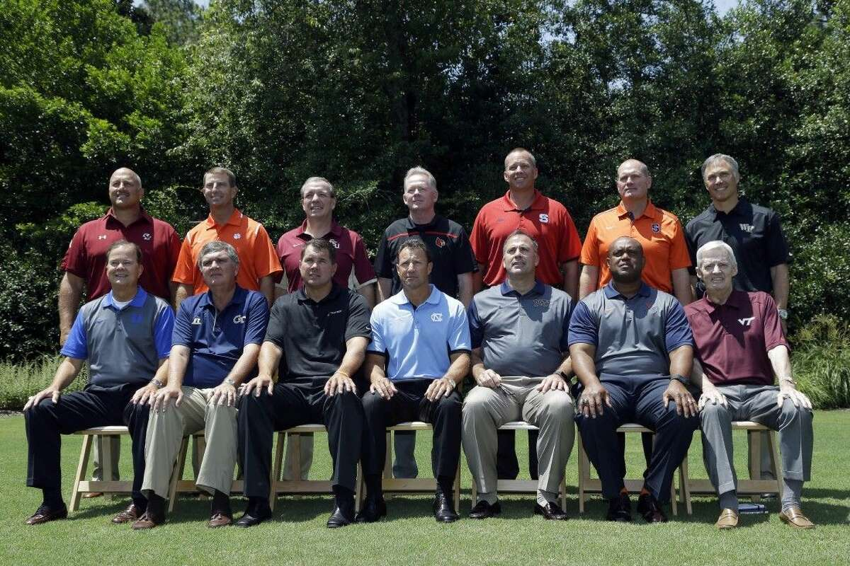 Atlantic Coast Conference coaches pose for a group photo during the ACC NCAA college football kickoff in Pinehurst, N.C., Tuesday. Seated from left is Duke coach David Cutcliffe, Georgia Tech coach Paul Johnson, Miami coach Al Golden, North Carolina coach Larry Fedora, Pittsburgh coach Pat Narduzzi, Virginia coach Mike London, and Virginia Tech coach Frank Beamer. Standing at rear from left is Boston College coach Steve Addazio, Clemson coach Dabo Swinney, Florida State coach Jimbo Fisher, Louisville coach Bobby Petrino, North Carolina State coach Dave Doeren, Syracuse coach Scott Shafer, and Wake Forest coach Dave Clawson.