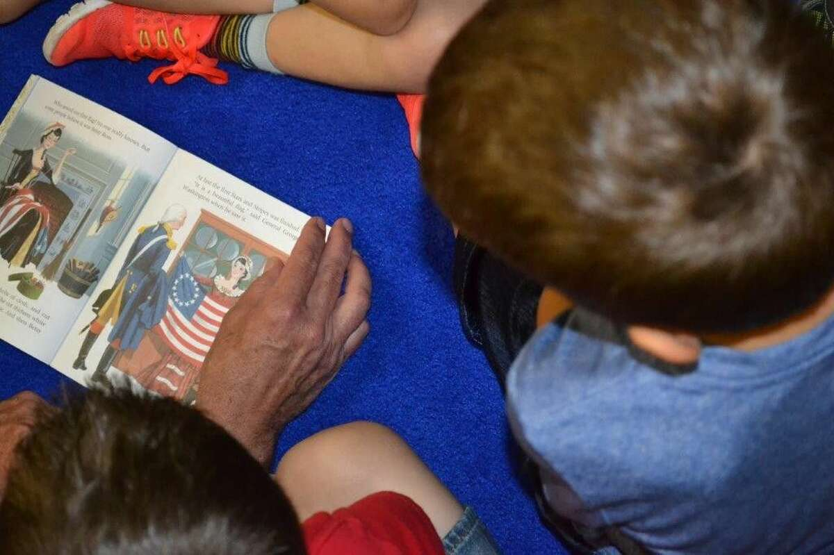 """Retired Marine Lt. Gen. Steven Hummer read """"Our Flag"""" to students from Glenwood Private School in Conroe on Monday as an early Flag Day celebration."""