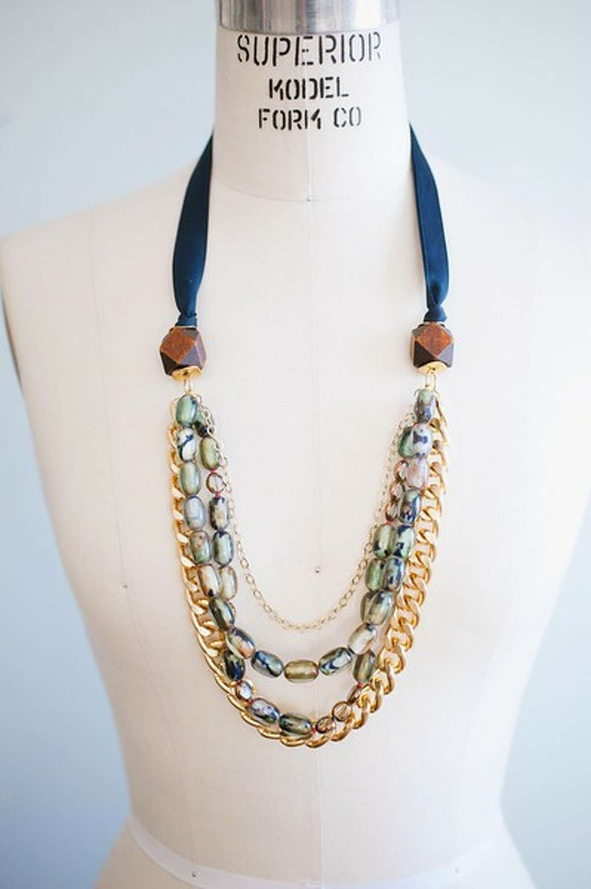 Just by adding a statement necklace, such as this Richmond necklace, some chunky bracelets or a bright-colored belt can turn a drab outfit into a polished look.