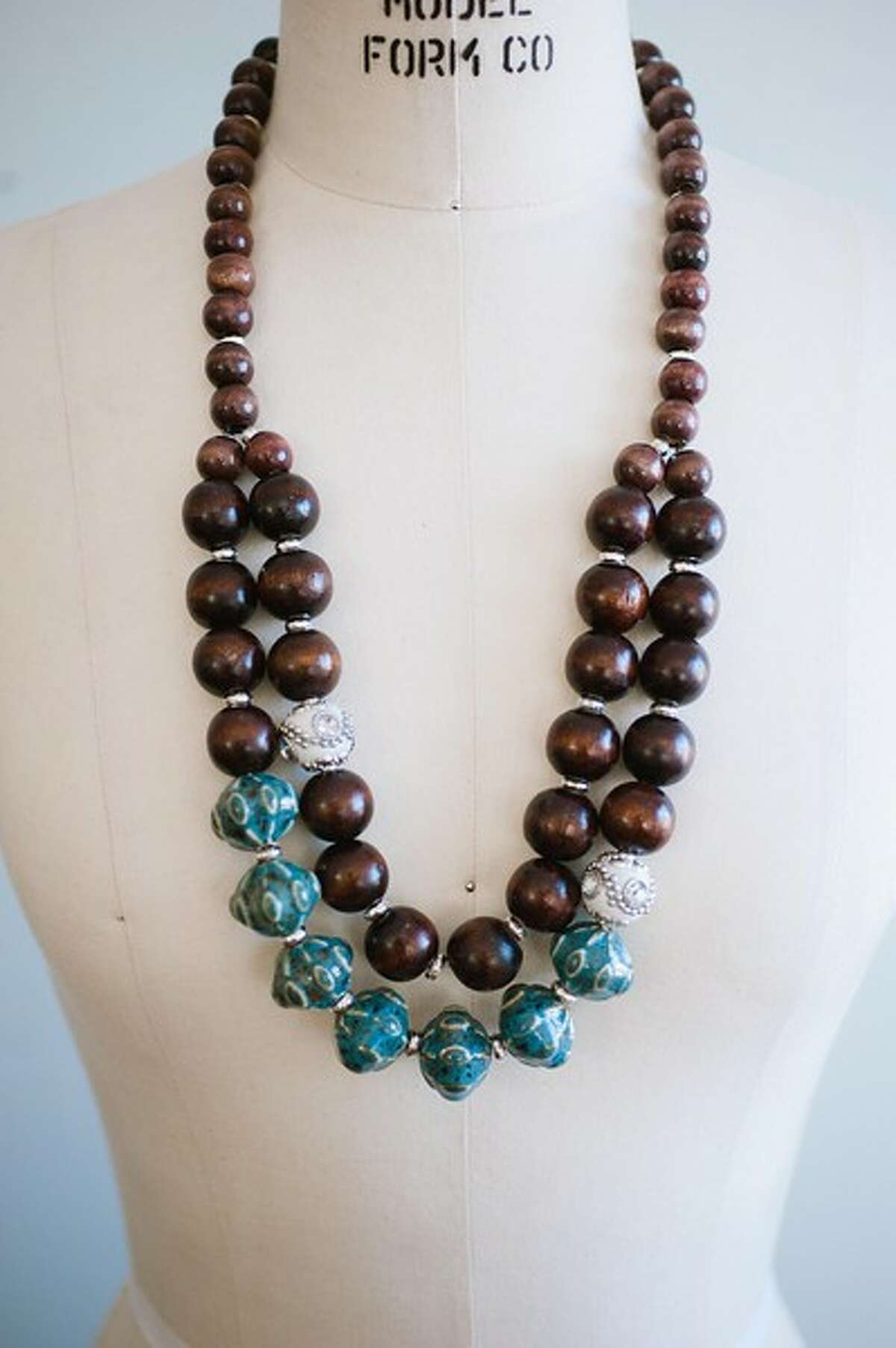 Just by adding a statement necklace, such as this Bali necklace, some chunky bracelets or a bright-colored belt can turn a drab outfit into a polished look.