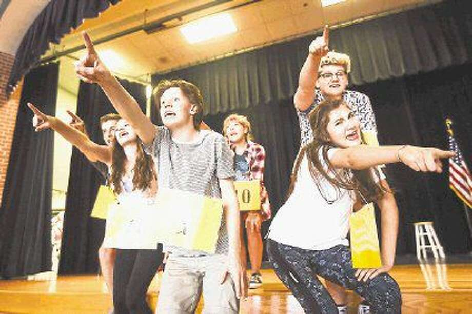 "The Woodlands High School students rehearse on Aug. 7, 2015 at The Woodlands High School Ninth Grade Campus for ""The 25th Annual Putnam County Spelling Bee."" TWHS Theater is one of 11 schools selected to perform at the International Thespian Festival June 20-25 in Lincoln, Nebraska. Before they go, students will present an encore, send-off show June 17-18 at The Woodlands High School."