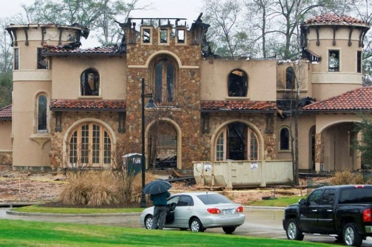 Fire damage is seen at a $2.5 million dollar 6,500-square foot home on S. Lamerie Way in the village of Carlton Woods in The Woodlands. The home, which was still in the final stages of construction, caught fire at approximately 11pm on Monday night.