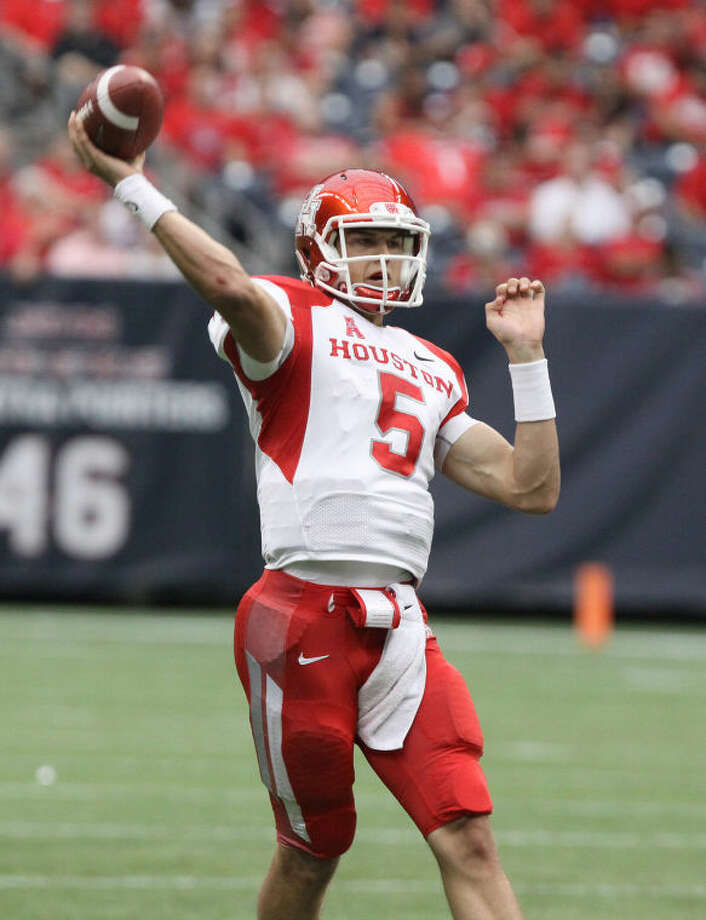 Houston's John O'Korn throws during the Bayou Bucket at Reliant Stadium Sept. 21 in Houston. O'Korn was named AAC Rookie of the Year. Photo: Alan Warren/HCN
