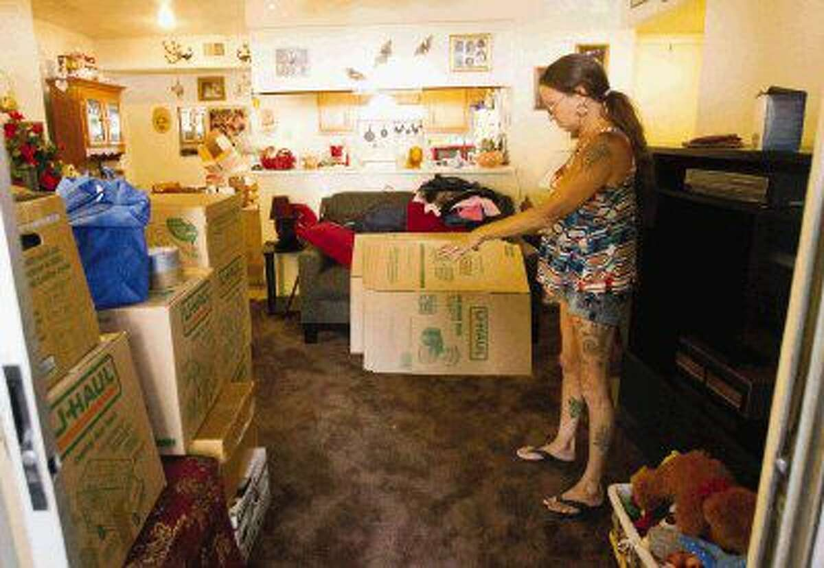 Tammy Bellaw stands in the middle of her apartment as she packs up Friday.