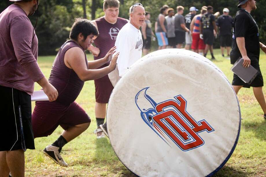 Magnolia linemen participate in the PowerDrive Push event during the Oak Ridge War Zone Lineman Challenge on Saturday at Oak Ridge High School. Photo: Michael Minasi