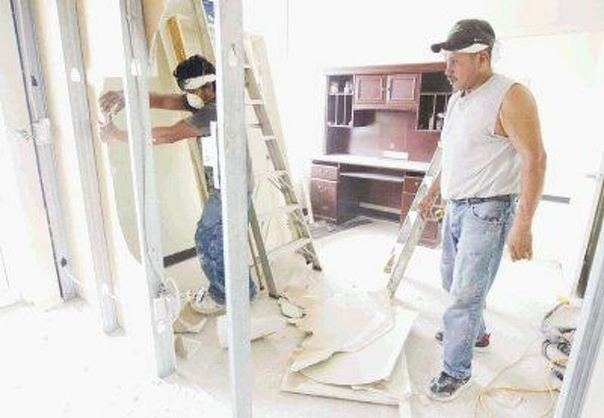 Construction work continued on an expansion of the Pregnancy Assistance Center North in Oak Ridge North Tuesday. The new medical wing will open in October to offer more medical services.