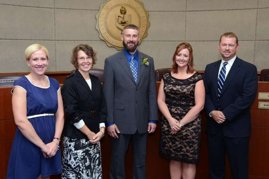 Wall of Fame: The 2013 Wall of Fame honorees were recognized in the Board Room of the Instructional Support Center on Monday. Pictured, from left to right, are Cy-Fair High School Biology II AP and Chemstry 1K teacher Anne Gill; Cypress Creek High School READ 180 teacher Andrea Barnes; Cypress Woods High School computer science teacher, business/computer science department chair and UIL academic coordinator Stacey Armstrong; CFISD secondary social studies curriculum coach Felicia Hayes; and Friend of Education Mark McShaffry, owner of The Backyard Grill and The Backyard Smokehouse.