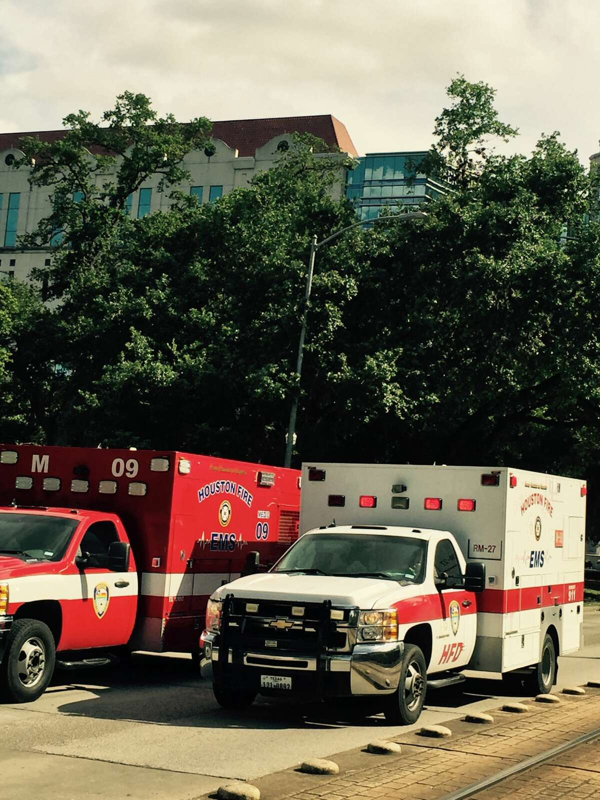 Emergency vehicles respond to a report of multiple people overdosing in Hermann Park on Thursday.