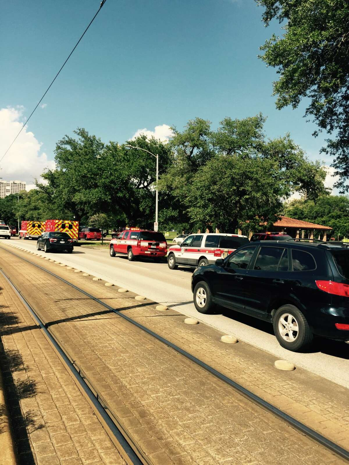 Emergency vehicles line the roads around Hermann Park on Thursday after reports of multiple people overdosing.