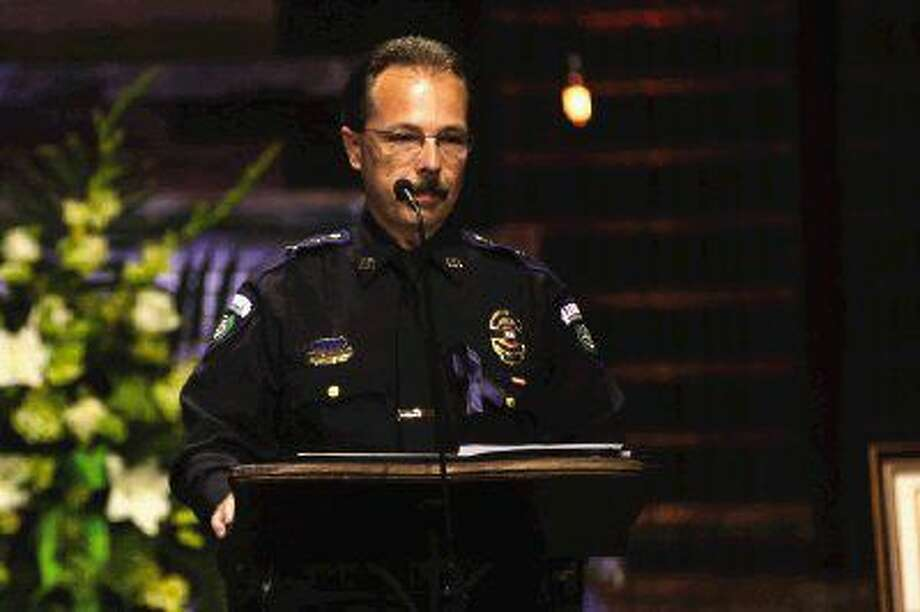 Chief of Police Leon Verot speaks during the funeral for Sgt. Stacey Baumgartner, of the Patton Village police department, on Friday at The Woodlands Church.