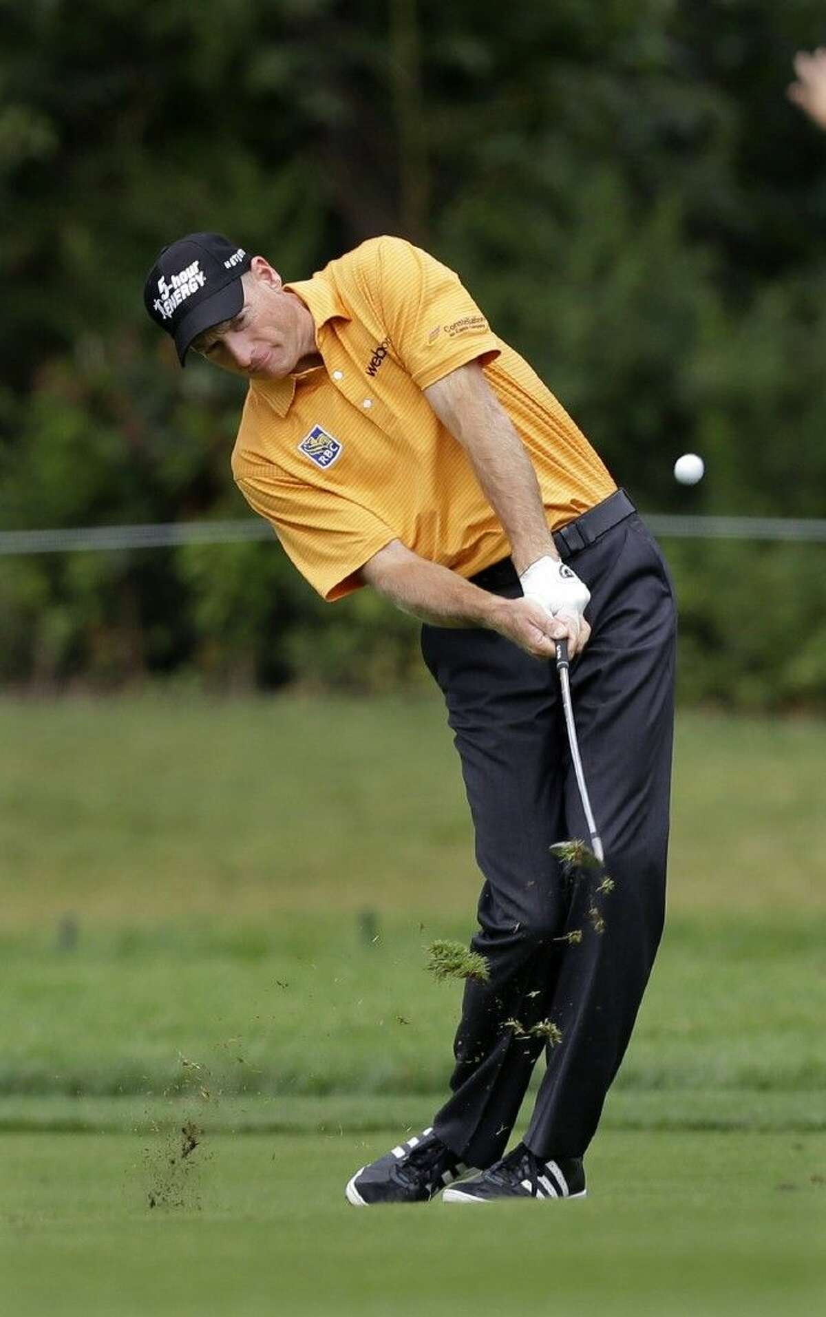 Jim Furyk hits a fairway shot on the first hole during the third round of play at The Barclays golf tournament Saturday in Paramus, N.J.