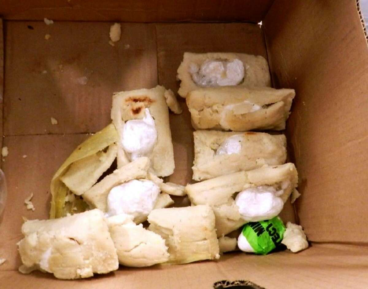 A photo provided by the US Customs and Border Protection shows tamales stuffed with several ounces of cocaine discovered at the at George Bush Intercontinental Airport in Houston, being transported by a man from El Salvador. A release from U.S. Customs and Border Protection obtained Sunday, Aug. 24, 2014, states that officers found 7 ounces of cocaine after selecting the 46-year-old man for additional screening. The release states that the drugs were seized and the traveler was turned over to the Houston Police Department.