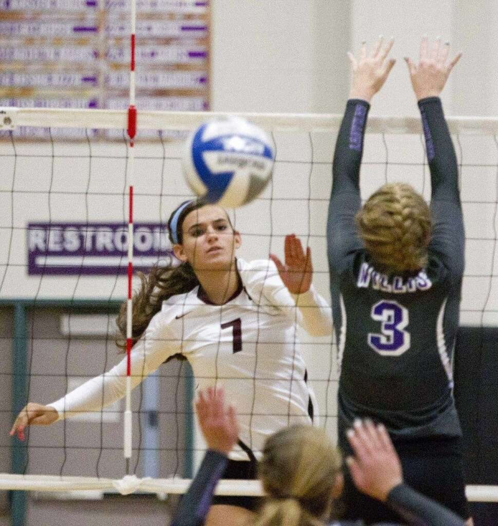 willis subdues magnolia in four sets the courier magnolia s morgan miller gets a shot past willis rebekah troy on tuesday at willis high