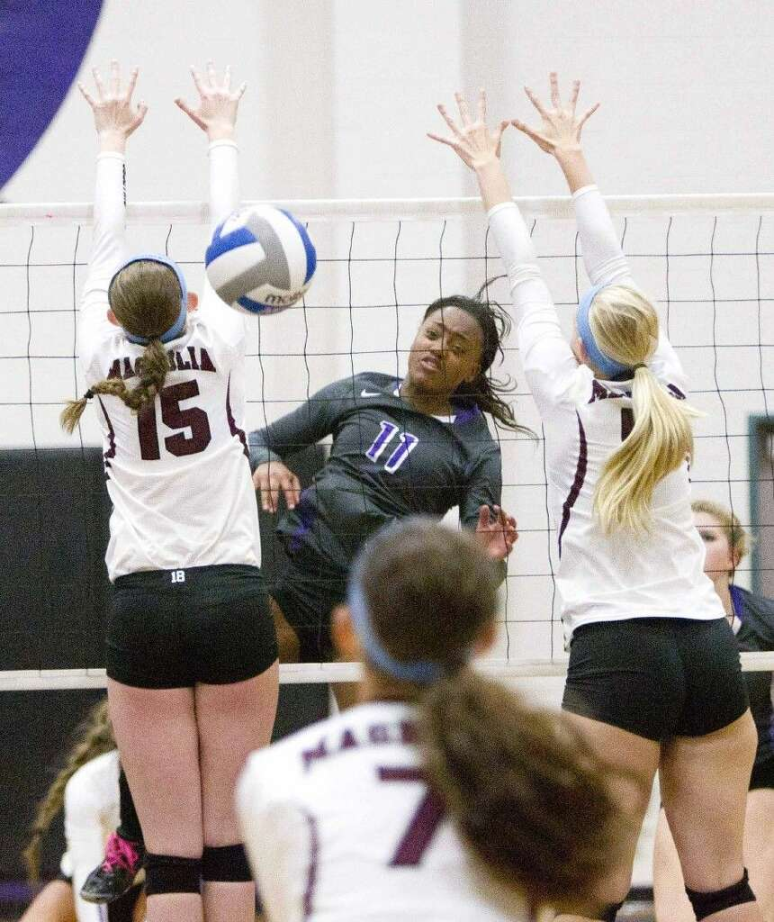willis subdues magnolia in four sets the courier willis ty johnson fires a shot between a pair of magnolia defenders on tuesday at