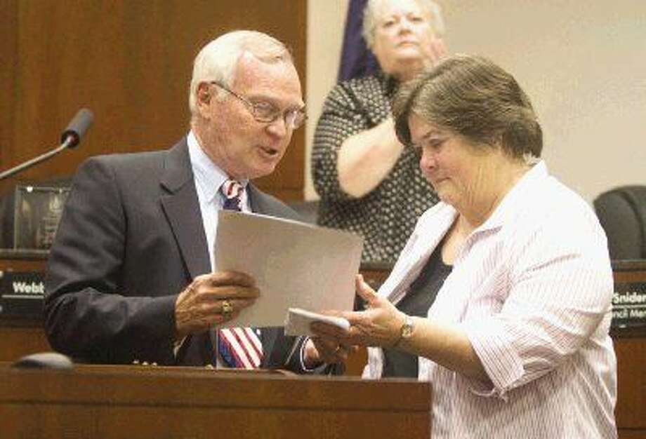 "Ann Lee, right, was presented a proclamation naming Aug. 14 ""Ann Lee Day"" in Conroe by Conroe City Councilman Gil Snider. Lee heads the Montgomery County Choral Society and is the music director at First United Methodist Church in Conroe."