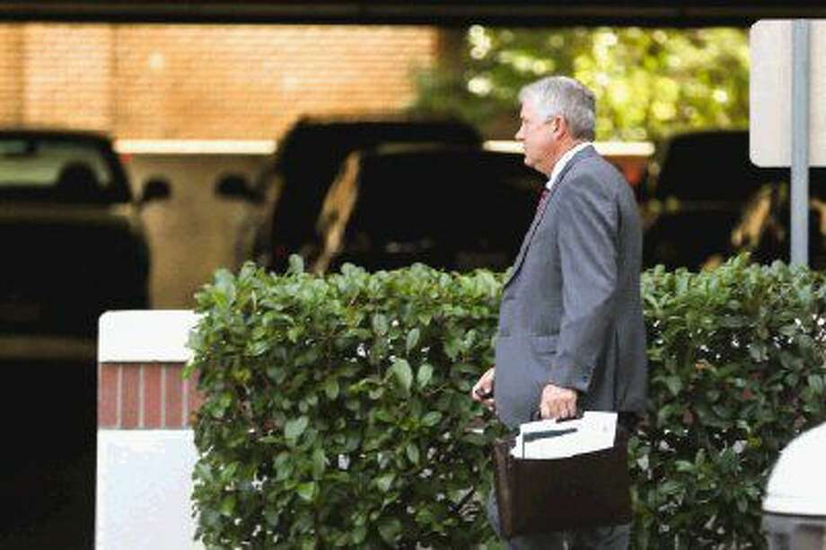 County Judge Craig Doyal leaves the Alan B. Sadler Building Tuesday after being suspended without pay following his indictment Friday regarding the Texas Open Meeting Act. Photo: Michael Minasi