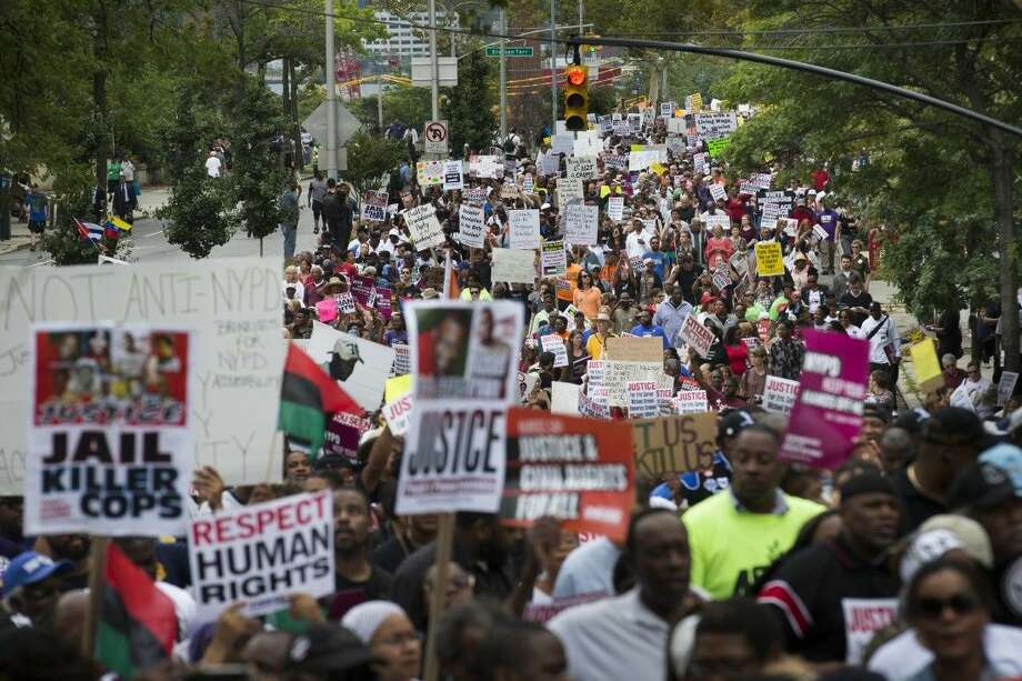 In this Aug. 23, 2014 file photo, demonstrators march to protest the death of Eric Garner in the Staten Island borough of New York. The city medical examiner ruled that Garner, 43, died as a result of a police chokehold during an attempted arrest. Details may differ, circumstances of their deaths may remain unknown, but the outrage that erupted after the Aug. 9 fatal shooting of the unarmed, black 18-year-old by a white officer in Ferguson, Missouri, has become a rallying cry in protests over police killings across the nation.