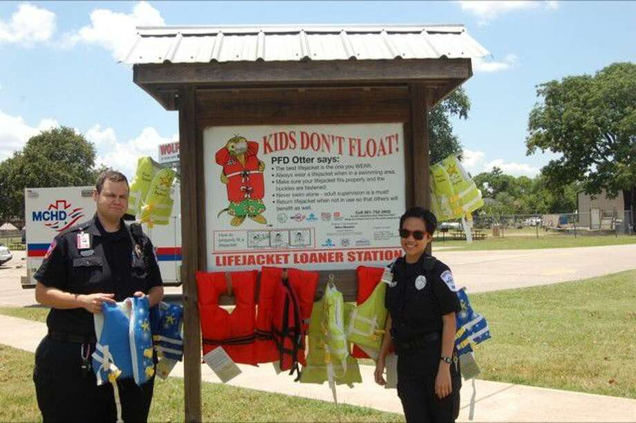 Montgomery County Hospital District Medic 45 crew Vivian Lam and Andy Adams of the loaner boards at Lake Conroe Park on TX-105.