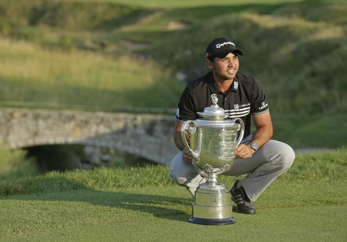 Australia's Jason Day poses with the Wanamaker Trophy after winning the PGA Championship.