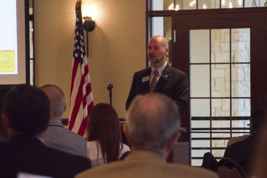 Ed Broussard, city manager of Missouri City, disscusses the city's five year Capital Improvements Program at the Missourti City Infrastructure Update at Quail Valley Country Club Thursday, Sept. 26, hosted by the Fort Bend Chamber of Commerce.