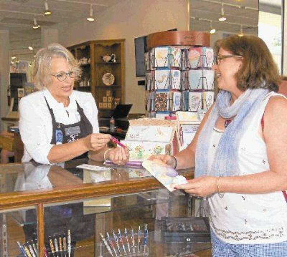 Jill Stacy of Houston, right, chooses a hand-crafted pen gift with the assistance of Cyndy Oller, volunteer store coordinator and New Danville board member.