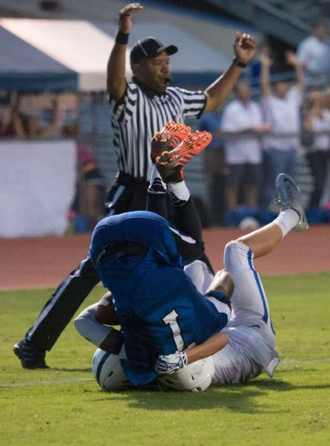 Episcopal running back Tyreik Gray tumbles over a St. Andrew's defensive back as the referee gets ready to signal a touchdown during the Knights' SPC South Zoen victory over the Crusaders Friday night at Simmons Field. Episcopal will go to archrival St. John's this Friday night in an important SPC matchup for both teams. Photo: Kevin B Long