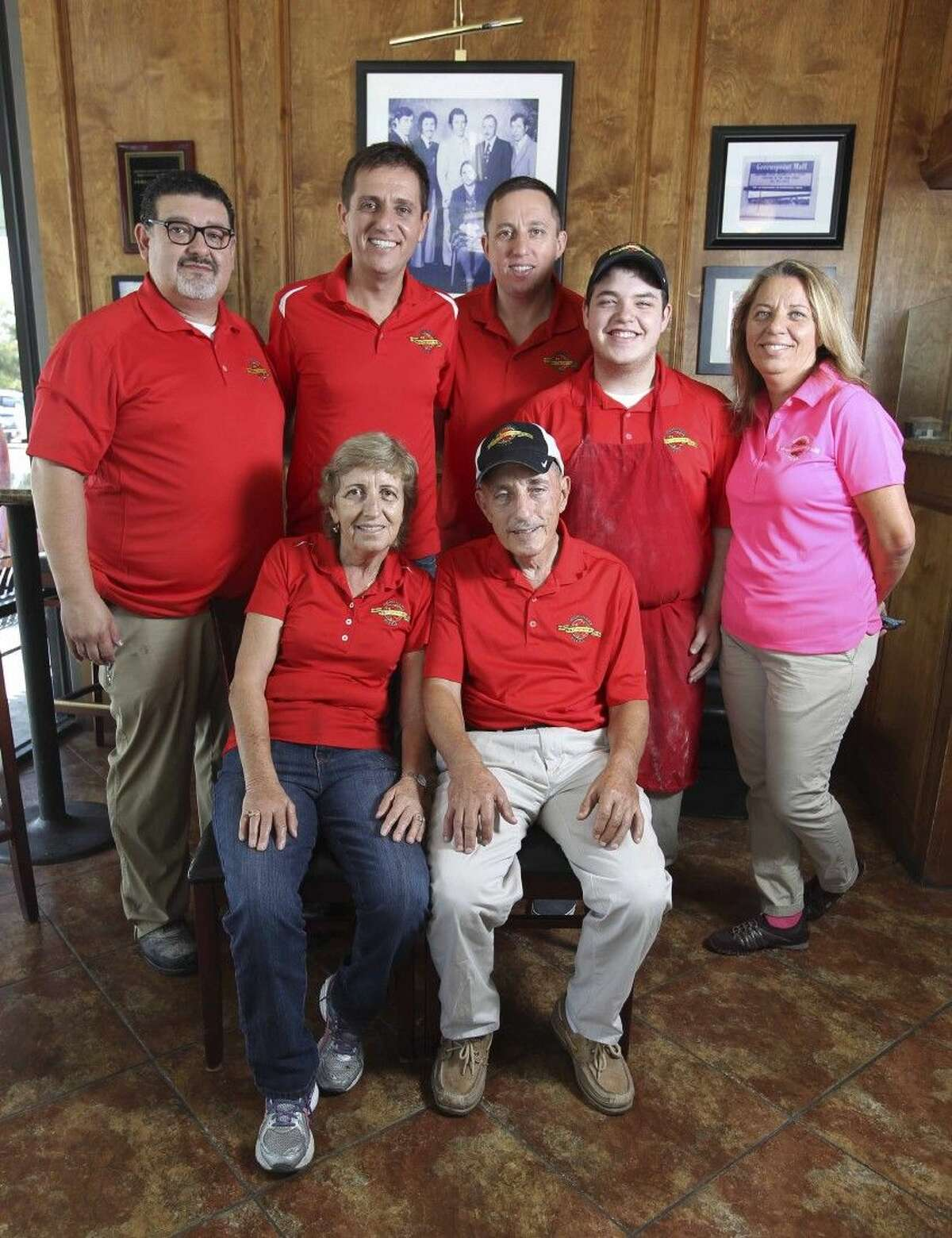 Pictured are the Bekiri family who founded the Brothers Pizza chain which has seven locations across Houston. They are all operated by members of the Bekiri family. Pictured seated are Zima and Haki Bekiri. Pictured standing from left are Jesse Lira, Manny Bekiri, Jimmy Bekiri, Noah Lira and Lima Bekiri Lira. Jesse and Lima Bekiri Lira own and operate the Sterling Ridge location of Brothers Pizza in The Woodlands. Her parents are Zima and Haki Bekiri.