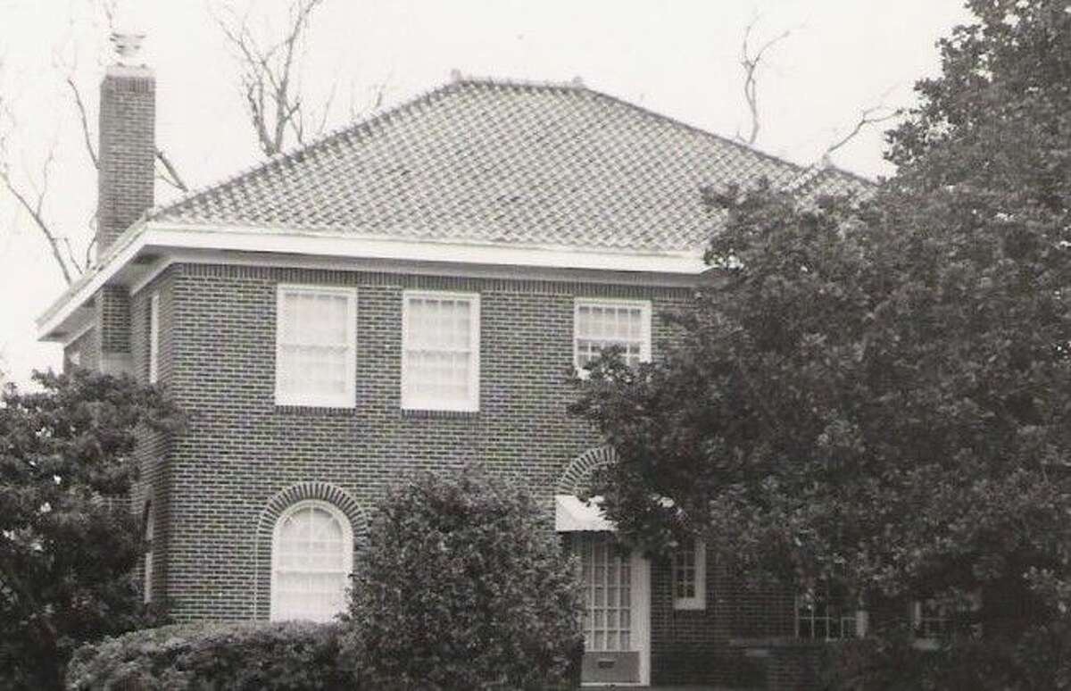 """An older photo of the Dr. Falvey home in Conroe. """"It was a big, elegant, four-bedroom house on the main street of Conroe at the time with large rooms,"""" said Olive Davis, daughter of Dr. Falvey, who grew up in the house. """"Whenever something big happened in Conroe, like a parade, it always went right past our house."""""""