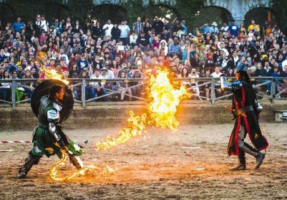 Texas Renaissance Festival performers participate in a sword fight during a show. The popular annual event, the largest Renaissance festival in the country, kicks off Saturday and continues weekends through Dec. 1. / Houston Event Photos