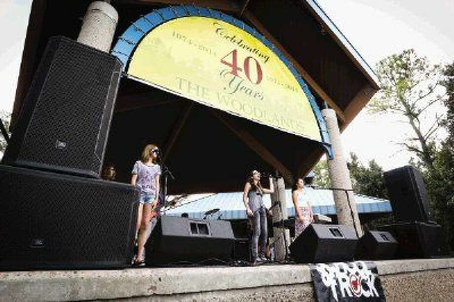 Students from School of Rock, a music performance school, perform during the The Woodlands 40th Anniversary Founders Day celebration on Sunday, Oct. 19, 2014, at Northshore Park.