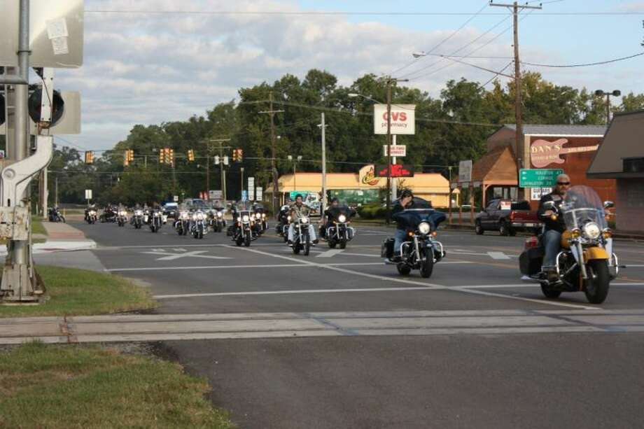 Approximately 100 motorcycle riders escorted the Vietnam Memorial Moving Wall through Cleveland on Thursday, Oct. 10. The wall will be open for visitors through Oct. 14 at the American Legion Post in Cleveland. Photo: RACHEL HALL