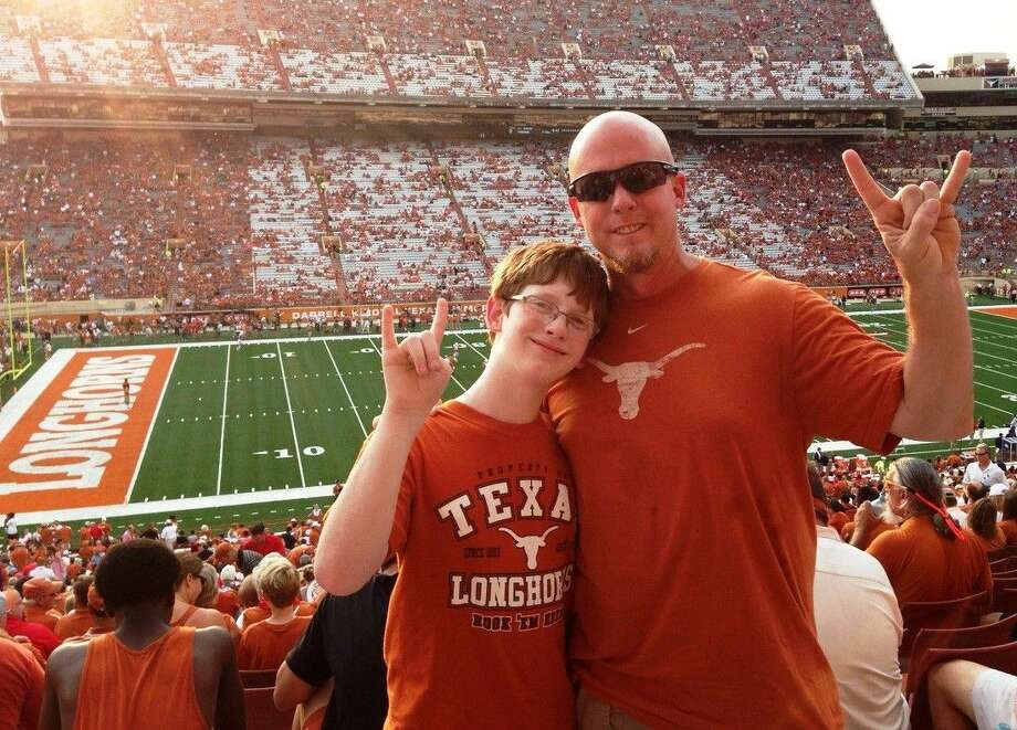 David James and his son Peyton together at a recent Longhorns football game. James lost his son to suicide Oct. 13 and wants to help others and keep the memory of his son alive. He hopes to make the meet of the Texas Interscholastic Swimming Coaches Association Nov. 21 a big collection event with coaches and swimmers bringing Products for Peyton. James had signed up for the Walk Out of the Darkness, but a swim meet took priority.