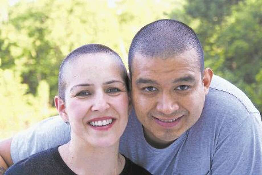 Solidarity: Myrna Montes' husband has been there every step of the way. He shaved his head right along with her. / @WireImgId=2642039