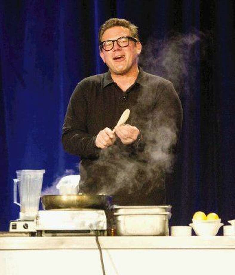 Celebrity Chef Tyler Florence gives a cooking demonstration at the Waterway Marriott Friday. Florence was in The Woodlands for the annual John Cooper School Signature Series.