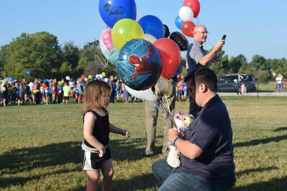 Relatives of the Sedlmeier family prepare for a balloon release at Madeley Ranch Elementary in the Montgomery ISD in honor of first-grader Harley Sedlmeier. Harley, his parents and 4-year-old sister were killed in a car accident on Texas 105 West Sunday.