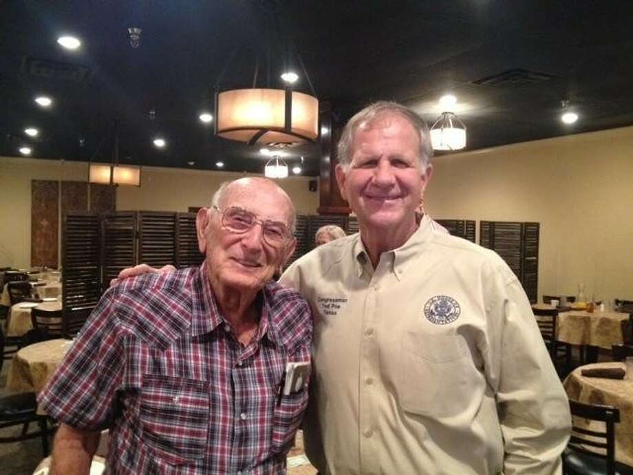Tom Morgan stands with Congressman Ted Poe. Morgan is the oldest lawman in Texas at 93 years old. He has served as a reserve deputy for the Harris County Sheriff's Office since he was 72 years old.
