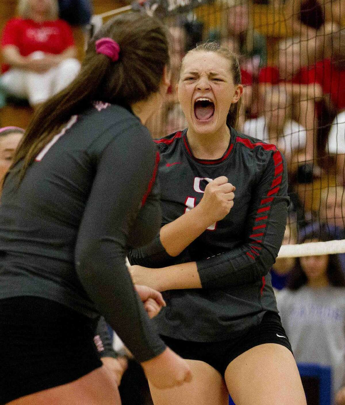 Oak Ridge's Hailey Lohnes celebrates a point in the first set of a gold bracket semifinal volleyball match during the Katy/Cy-Fair Nike Invitational. Go to HCNpics.com to purchase this photo and others like it.