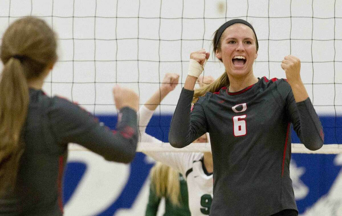 Oak Ridge's Molly Russell celebrates a point in the fourth set of the gold bracket championship volleyball match during the Katy/Cy-Fair Nike Invitational. Go to HCNpics.com to purchase this photo and others like it.
